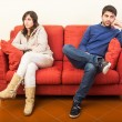 Young Couple on the Sofa after Quarrel — Stock Photo #19309175