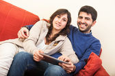 Young Couple on the Sofa with Tablet PC — Fotografia Stock