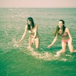 Women Playing in the Water at Seaside — Stock Photo #19514589