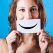 Young Woman with Smiley Emoticon on Blue Background — Stok fotoğraf