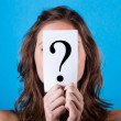 Royalty-Free Stock Photo: Woman Hiding Behind a Question Mark
