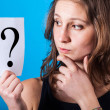 Doubtful Womwith Question Mark — Stock Photo #19637531