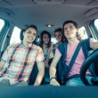 Four Friends in the Car Leaving for Vacation — Stock Photo #19637549