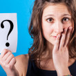Doubtful Woman with a Question Mark — Stock Photo #19637555