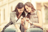 Two Beautiful Women Sending Messages with Mobile — Photo
