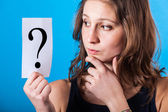 Doubtful Woman with a Question Mark — Stock Photo