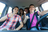 Four Friends in the Car Leaving for Vacation — Stock Photo