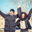 Happy Young Couple with Outstretched Arms — Stock Photo