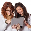 Two Teenage Female Student with Digital Tablet — Stock Photo