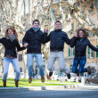 Happy Group of Friends Jumping Outdoor — Stock Photo