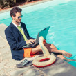 Funny Young Businessman with SwimmingTrunks next to the Pool — Stock Photo #21146633