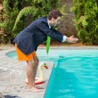 Stock Photo: Funny Young Businessman with SwimmingTrunks Diving into the Poo