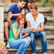 Group of Teenage Friends with Tablet PC — Stock Photo