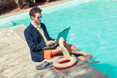 Funny Young Businessman with SwimmingTrunks next to the Pool — Stockfoto