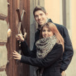 Man and Woman in front of Home Main Entrance — Stock Photo #21831529
