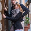 Man and Woman in front of Home Main Entrance — Stock Photo #21832473