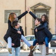 Two Happy Women Piggyback on their Boyfriends — Stockfoto #21836371