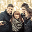 Group of Friends taking Self Portraits with Mobile Phone — Stock Photo #21836991