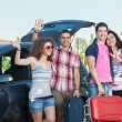 Four Friends Ready to Leave For Vacation — Stock Photo