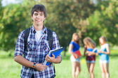 Young Boy Student with Friends at Park — Stock Photo