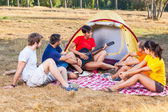 Group of Camping and Singing — ストック写真