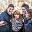 Group of Friends taking Self Portraits with Mobile Phone — Stock Photo #23676133
