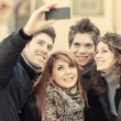 Group of Friends taking Self Portraits with Mobile Phone — Stock Photo