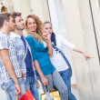 Happy Girls With Bored Boys on Shopping — Stock Photo #24415479