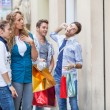 Happy Girls With Bored Boys on Shopping — Stock Photo #24415643