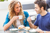 Young Couple Having a Traditional Italian Breakfast — Stock Photo