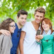 Group of Teenage Friends Taking Self Portraits with Mobile Phone — Stock Photo