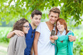 Group of Teenage Friends Taking Self Portraits with Mobile Phone — ストック写真