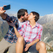 Couple Taking Self Portrait at Top of Mountain — Stock Photo
