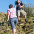MHelping His Girlfriend Hiking — Foto de stock #24753987