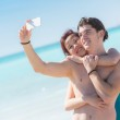 Young Couple Taking Self Portrait with Mobile at Beach — Stock Photo