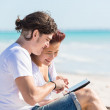 Young Couple at Seaside with Digital Tablet — Stock Photo