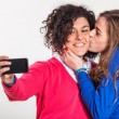 Stock Photo: Two Beautiful Women Taking Self Portrait with Mobile Phone