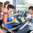 Royalty-Free Stock Photo: People Running on Treadmill in the Gym