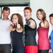 Group of at Gym with Thumbs Up — Stock Photo #25565449
