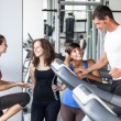 Stock Photo: Attractive Man at Gym with Three Women