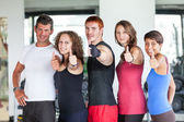 Group of at Gym with Thumbs Up — Stock Photo