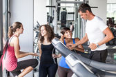Attractive Man at Gym with Three Women — Stock Photo