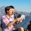 Couple with Digital Tablet at Top of Mountain — Stock Photo
