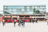 Crowd at rush hour in front of train station — Stock Photo