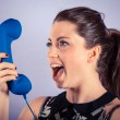 Young Woman Shouting Against Receiver — Stock Photo