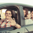 Boys and Girls in a Car Leaving for Vacation — Stock Photo #25956613