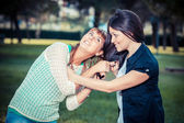 Two young women fighting — Stock Photo