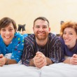 Man with two women on the bed — Stock Photo