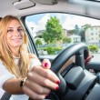 Young woman driving her car — Stock Photo