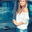Happy young woman with her new car — Stock Photo